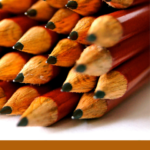 Pinterest image with pencils stacked on one another Text says Organise your pencils by type and lightfastness - read the post at Artnitso.com