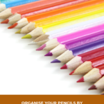 Pinterest image with coloured pencils in a line on a white surface. Text says Organise your pencils by type and lightfastness - read the post at Artnitso.com