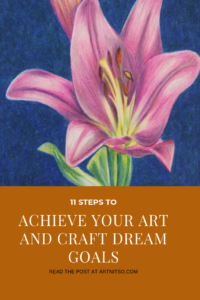 "Pinterest image of coloured pencil drawing of pink and green lily on blue background. Text says ""11 steps to achieve your art and craft dream goals. Read the post at Artnitso.com'."