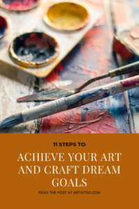 "Pinterest image of painting palette, palette knife, brush on painted surface. Text says ""11 steps to achieve your art and craft dream goals. Read the post at Artnitso.com'."