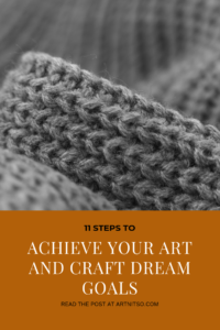 "Pinterest image of grey knitted fabric. Text says ""11 steps to achieve your art and craft dream goals. Read the post at Artnitso.com'."