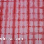 Red patterned hand dyed fabric. Artnitso.com