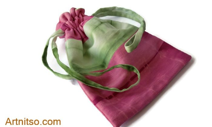 How to recycle old sheets. Handmade drawstring bag. Outer fabric upper half and drawstring is hand-dyed green with the lower half and upper also hand dyed fuschia. Artnitso.com