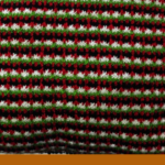 "Pinterest image of part of knitted pillow in green, black, red and white. Text says ""Do you feel better after doing something artsy? Read the post at Artnitso.com"""
