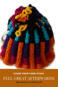 "Pinterest image of a multicoloured knitted tea cosy. Text says ""Clear your yarn stash - feel great afterwards. Read the post at Artnitso.com"""