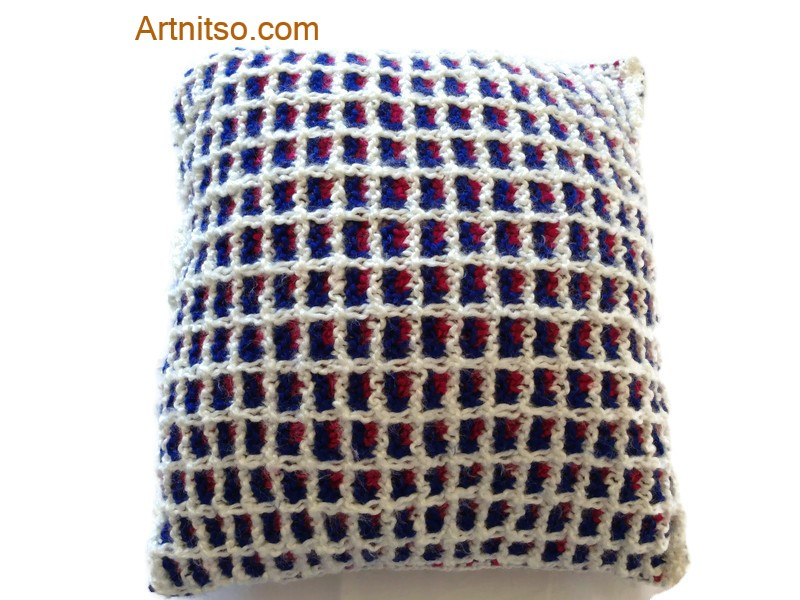 The result of using art and craft to balance emotions. Hand knitted pillow in white, blue and fuschia Patons Toto Kids yarn. Artnitso.com text.