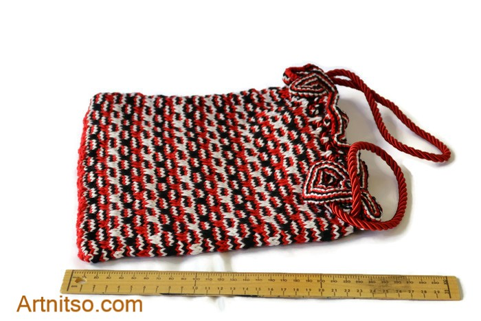The result of using art and craft to balance emotions. Hand knitted cotton bag with red cord drawstring handle. Red, Black and White patterned cotton. Artnitso.com text.