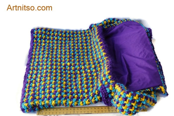 The result of using art and craft to balance emotions. Hand knitted bag lined with purple poly cotton. Yellow, purple and blue pattern using Patons Toto Kids yarn. Artnitso.com text.