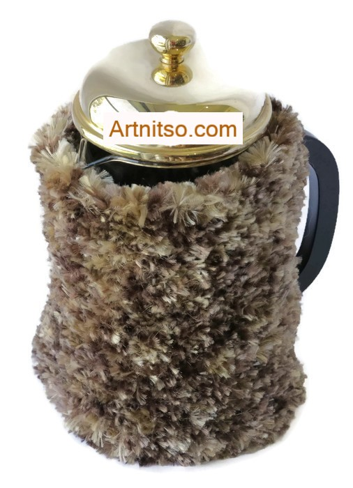 The result of using art and craft to balance emotions. Hand knitted mottled brown plunger warmer. Knitted in Flurry yarn. Artnitso.com text.