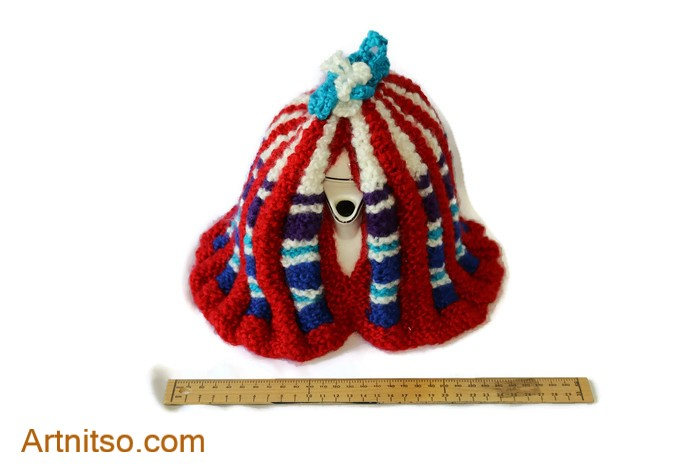The result of using art and craft to balance emotions. Hand knitted tea cosy using red, white, light blue, dark blue Patons Toto Kids yarn. Artnitso.com text.