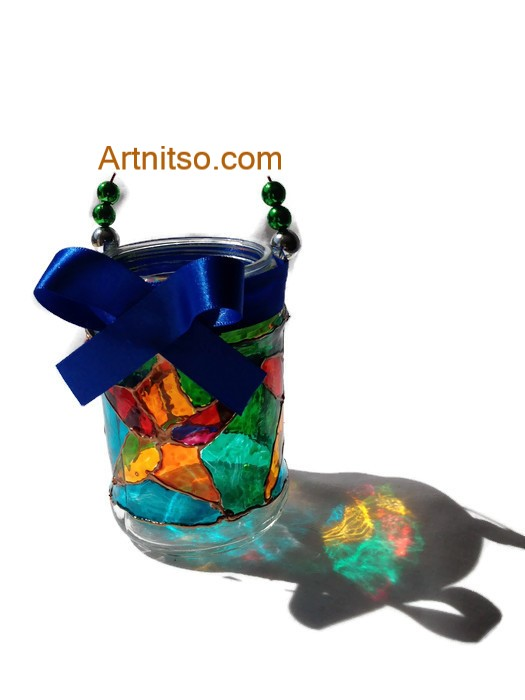 Painted glass jar in yellow, red, blue and green. Artnitso.com