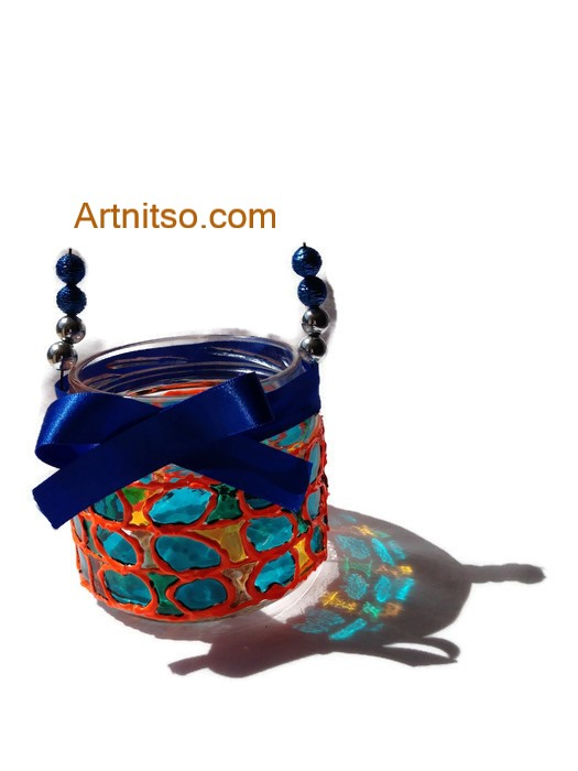 Painted glass jar in orange, yellow and blue. Artnitso.com