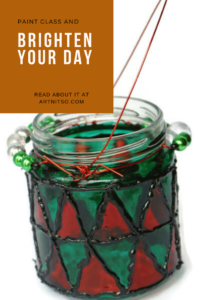 Pinterest image of red, green and black painted glass jar wih silver and green beads. Text says 'Paint glass and brighten your day. Read about it at Artnitso.com.