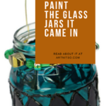 Pinterest image of blue and mauve painted glass jar with gold and green beads. Text says 'just as tasty as jam. Paint the glass jars it came in. Read about it at Artnitso.com.